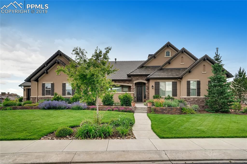 Stunning ranch home in a private and gated Flying Horse community.