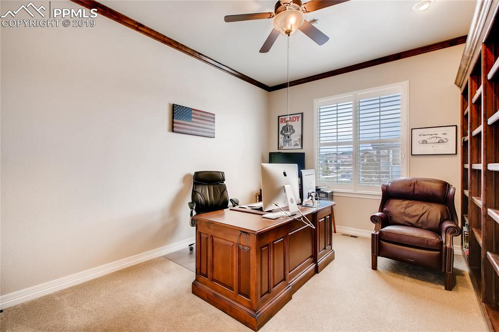 Main level office with a walk-in closet