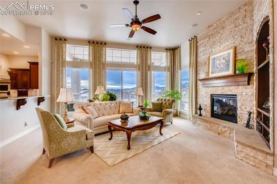 Great room with a stacked stone gas fireplace and amazing views