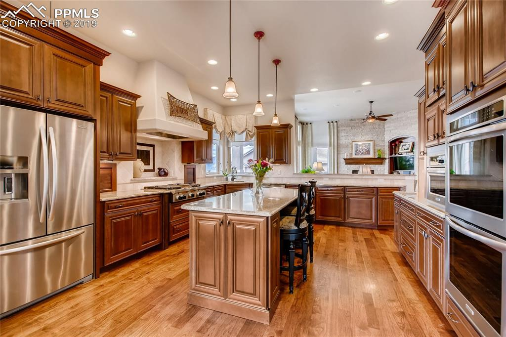 Center island with pendant lighting and breakfast bar