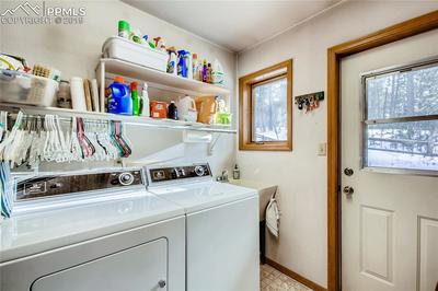Laundry Room with exterior door.