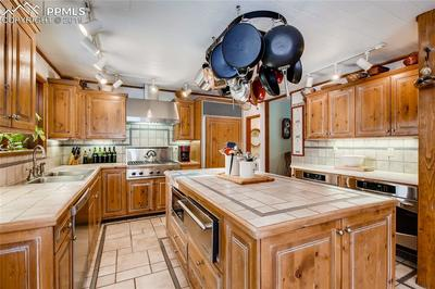 Spacious gourmet kitchen with center island