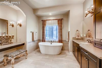 Beautiful master spa with a soaking tub and His and Her vanities