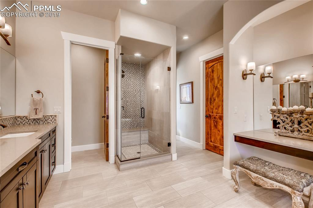 A beautiful showing and a huge walk-in closet complete the master