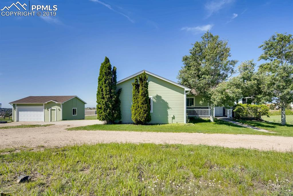 Beautiful home with extra detached garage (toy storage) and 3 stall barn.