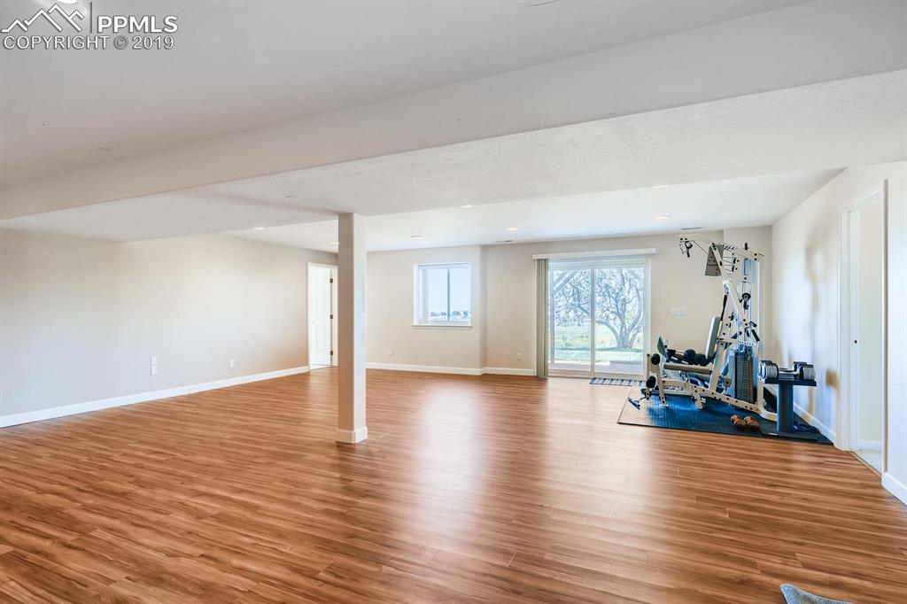 This room is limited only by your needs and your imagination.  It also walks out to a beautiful patio and grassy area.