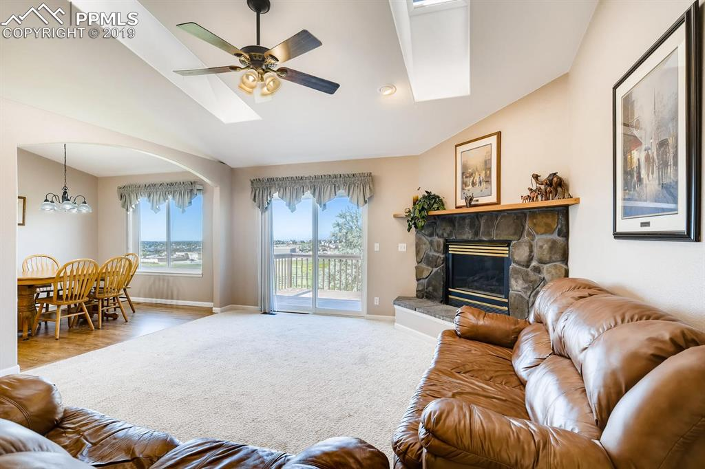 The great room showcases the beautiful mountain views from inside and from the deck.