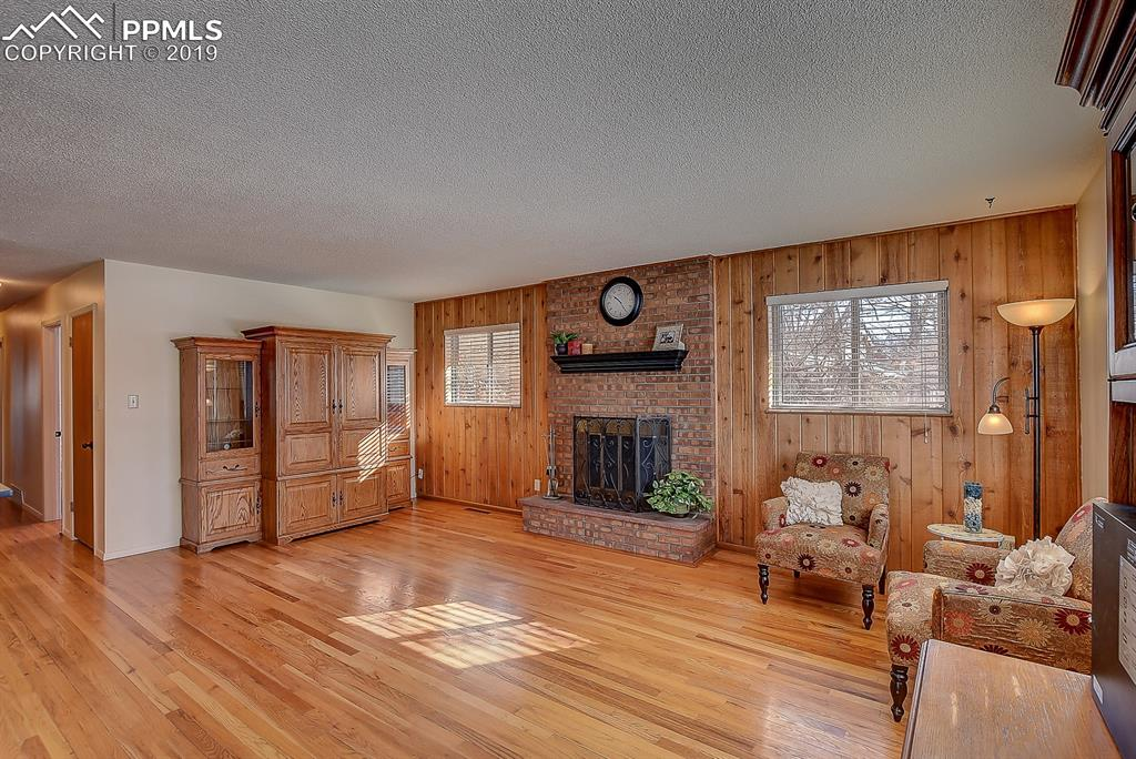 Living Room with Gas Burning Fireplace and Hardwood Floors!
