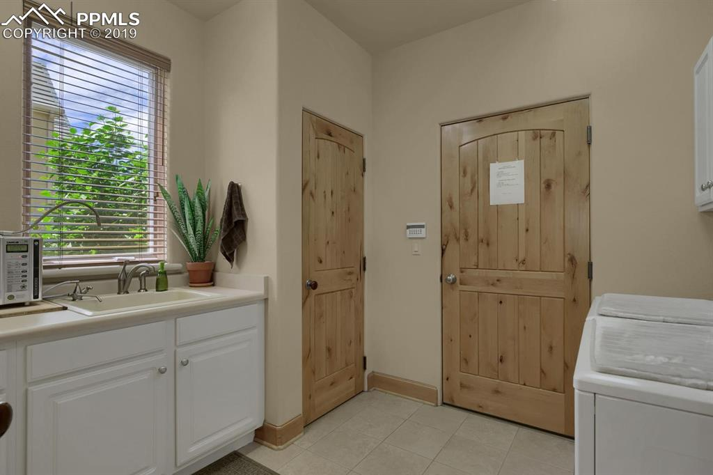 Great Laundry Room w/Sink and Coat Closet
