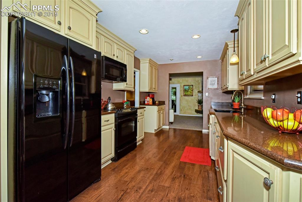 Large kitchen with updated cabinets, floors, appliances!