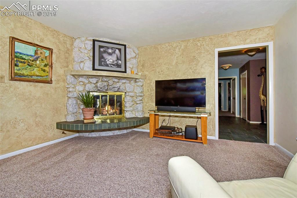 Living room opens to family room with second fireplace