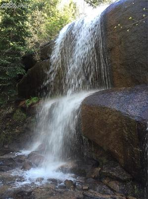 One of the community waterfalls. A 10-15 min walk from this listing!
