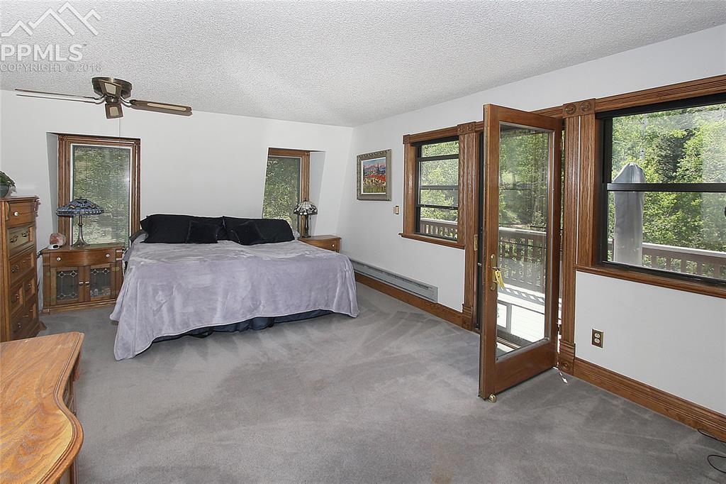 Master Bedroom Upper Level Vie-- Enjoy adjoining Deck  with view of the Trout Po