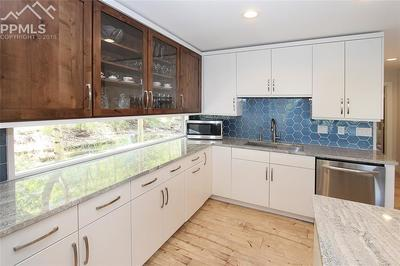 View # 3--Kitchen flooded with Natural Light from well appointed windows!