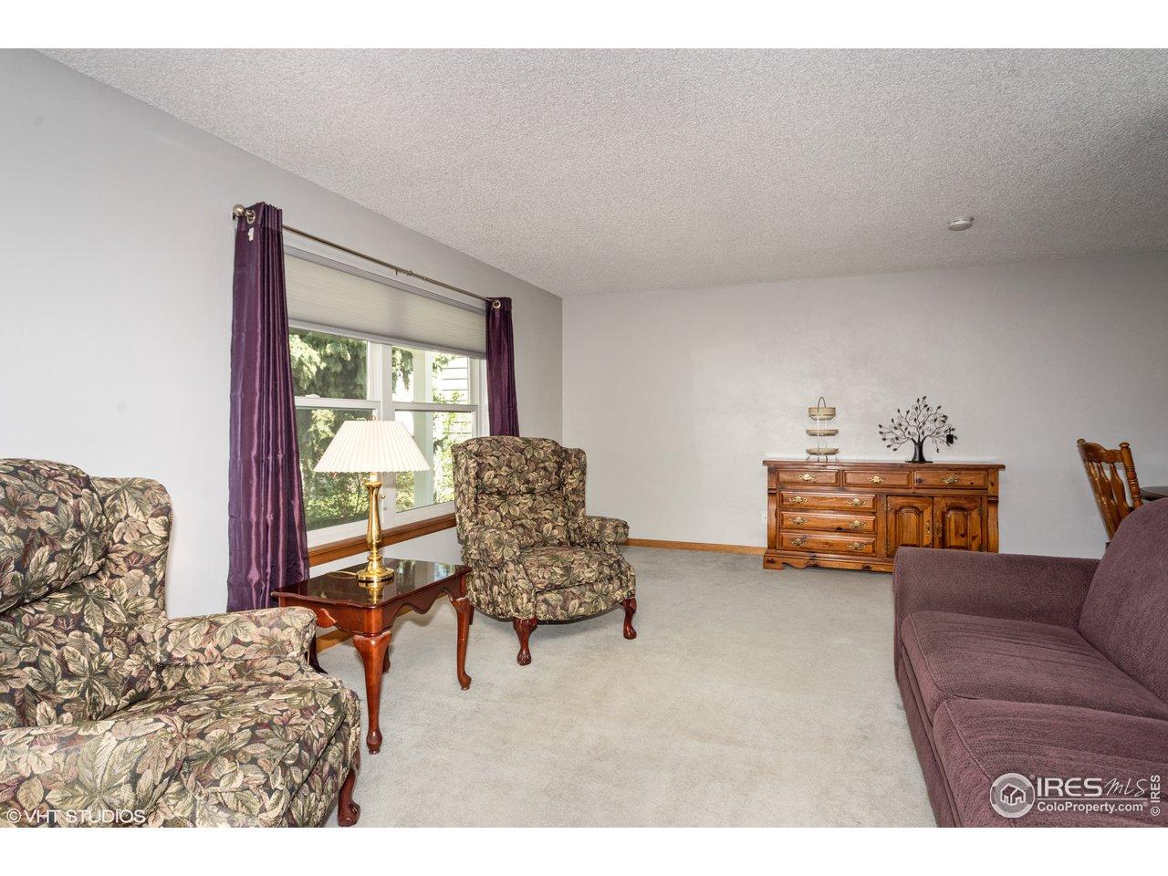Formal living room. Double pane vinyl windows