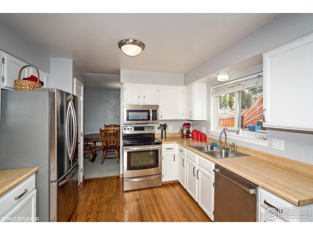 Stainless steel appliances,wood floors