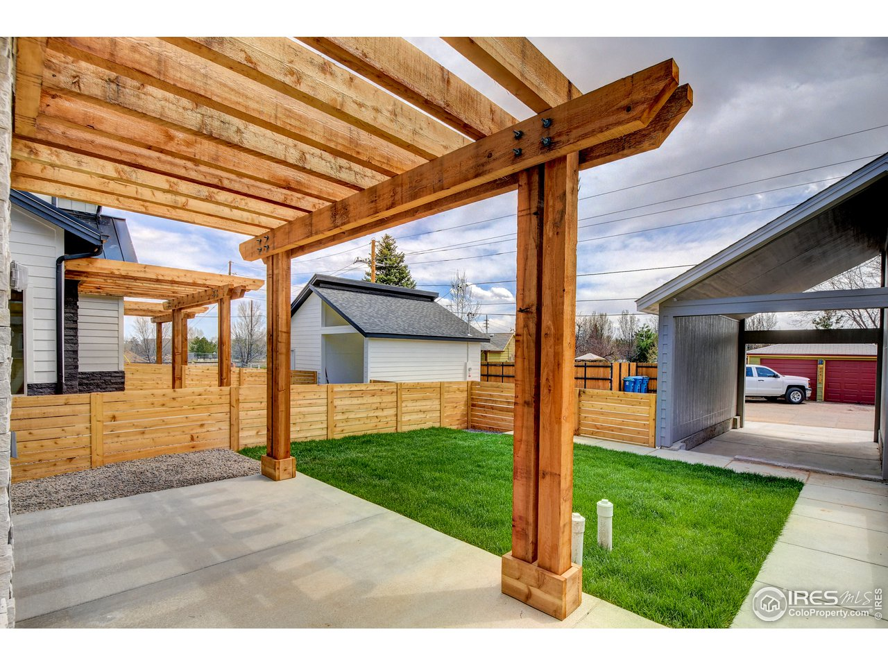 Fenced yard with south facing Pergola + fireplace
