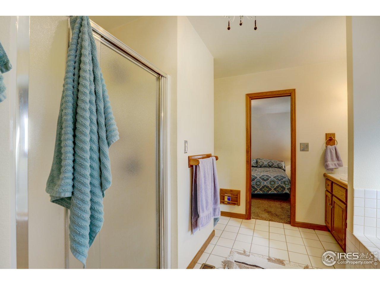 Primary private bath. separate shower.
