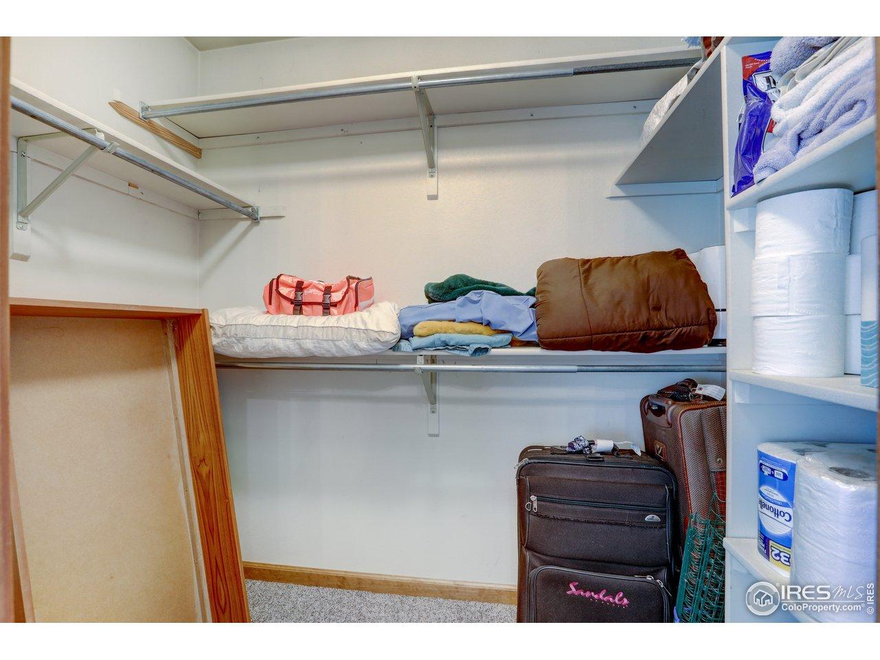 Primary bedroom walk in closet.