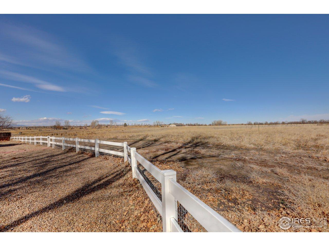 Backs to acres of open farm land