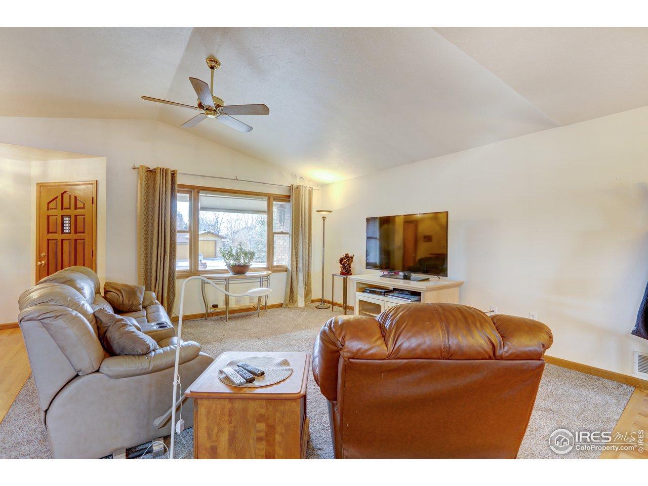 Livingroom has vaulted ceiling and bay window