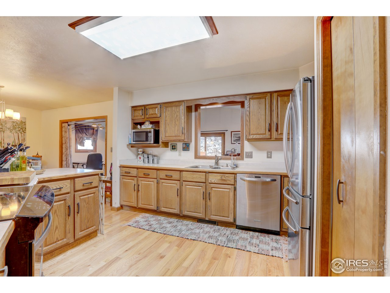 Open kitchen with stainless steel appliances.
