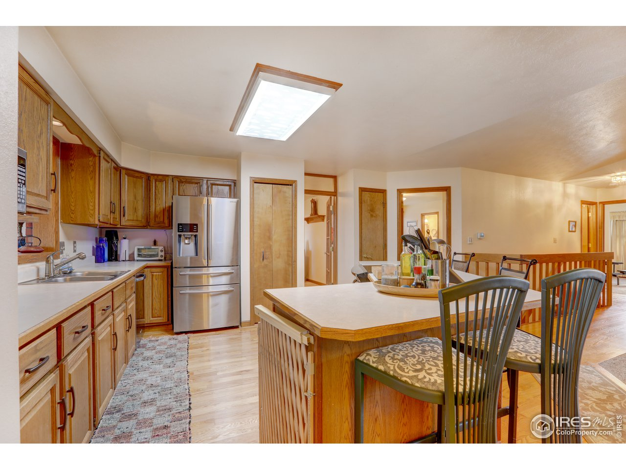 Hardwood floors in kitchen and dining area