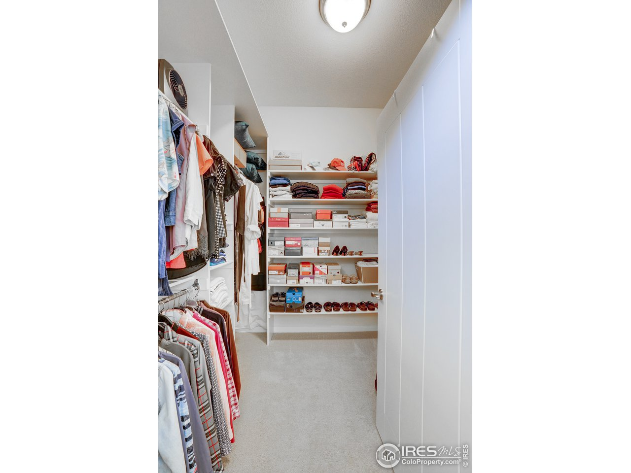 Primary bedroom walk in closet