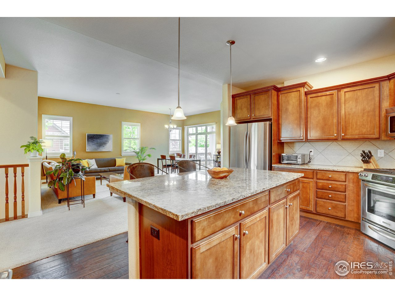 Gorgeous kitchen with granite countertops and gas range.