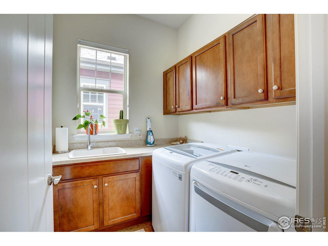 Main floor laundry room with deep sink