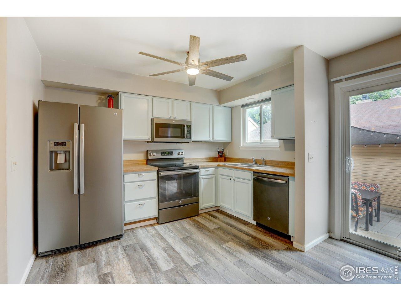 Stain less steel appliances, laminate flooring, upgraded lighting