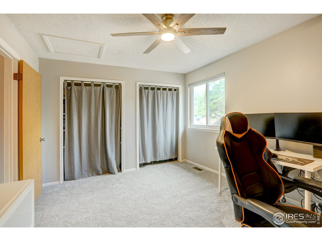 2nd bedroom has ceiling fan and new carpet