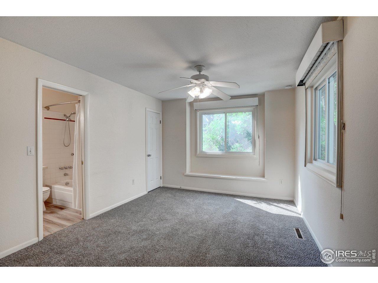 2nd floor bedroom with ceiling fan