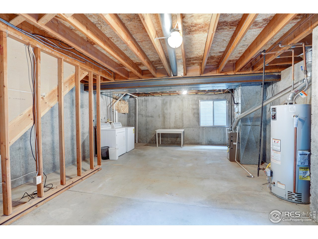 unfinished basement with washer and dryer hook ups