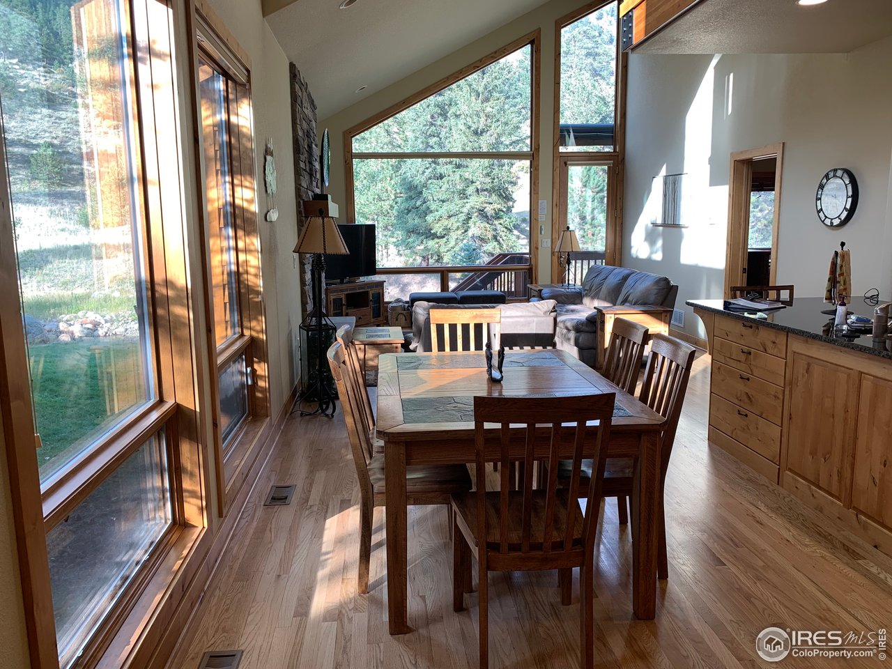 Two Story Dining Area with hardwood floors