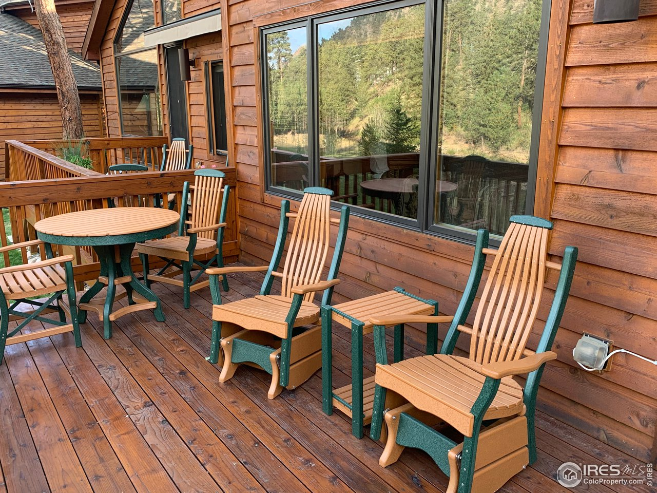 Deck faces the Fall River (patio furniture is included)