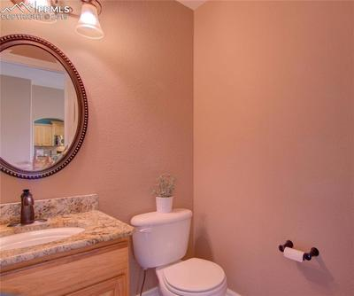Main level 1/2 guest bath with granite counter.