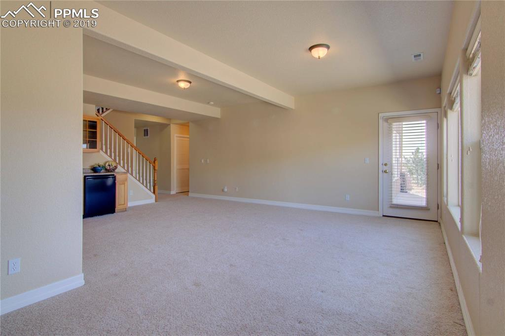 Basement family room w/walkout to yard and wet bar area.