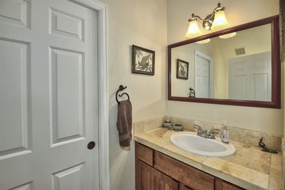 A convenient and nicely-appointed guest half-bath is located on the main level!