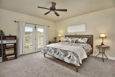 French doors in the roomy master suite frame the views!