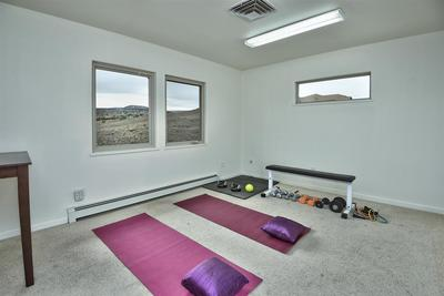 What will you do with the two bonus rooms above the garage? - Gym? Office? Playroom? Man cave?