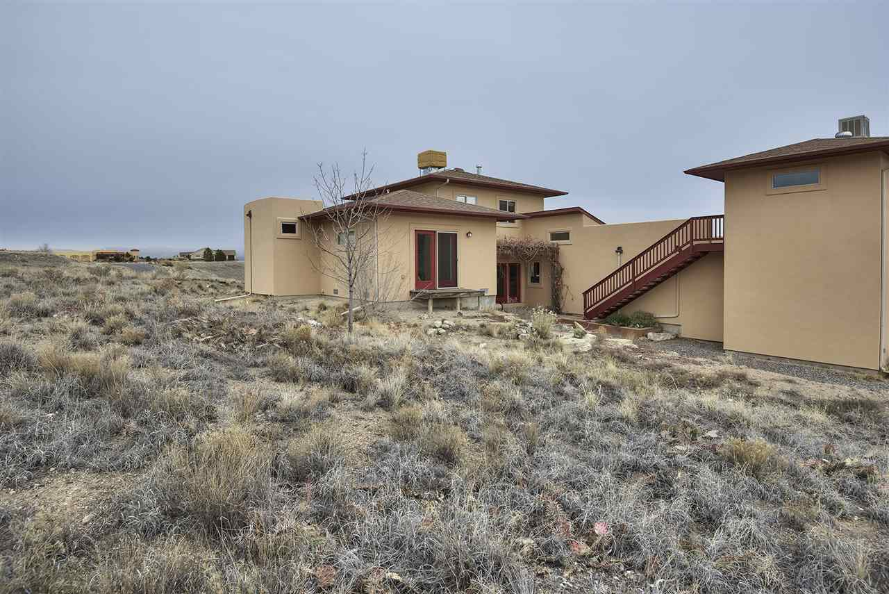 Enjoy the natural beauty of nature's original landscape, with no mowing needed, in this custom home!