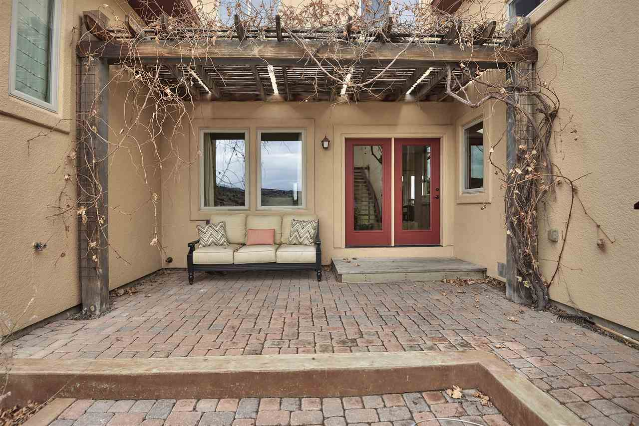 A shady grape arbor covers the back patio and is a cool and quiet spot in summer!