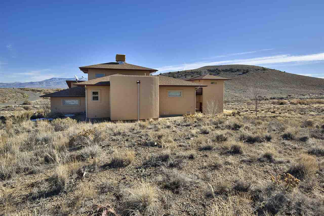 No rear neighbors! This custom-built Redlands home backs to BLM land!