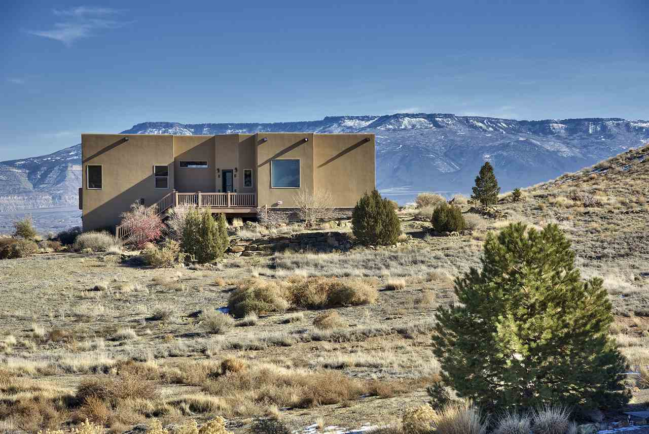 This home showcases the best views of the Grand Valley - the Grand Mesa, Bookcliffs & the Monument!