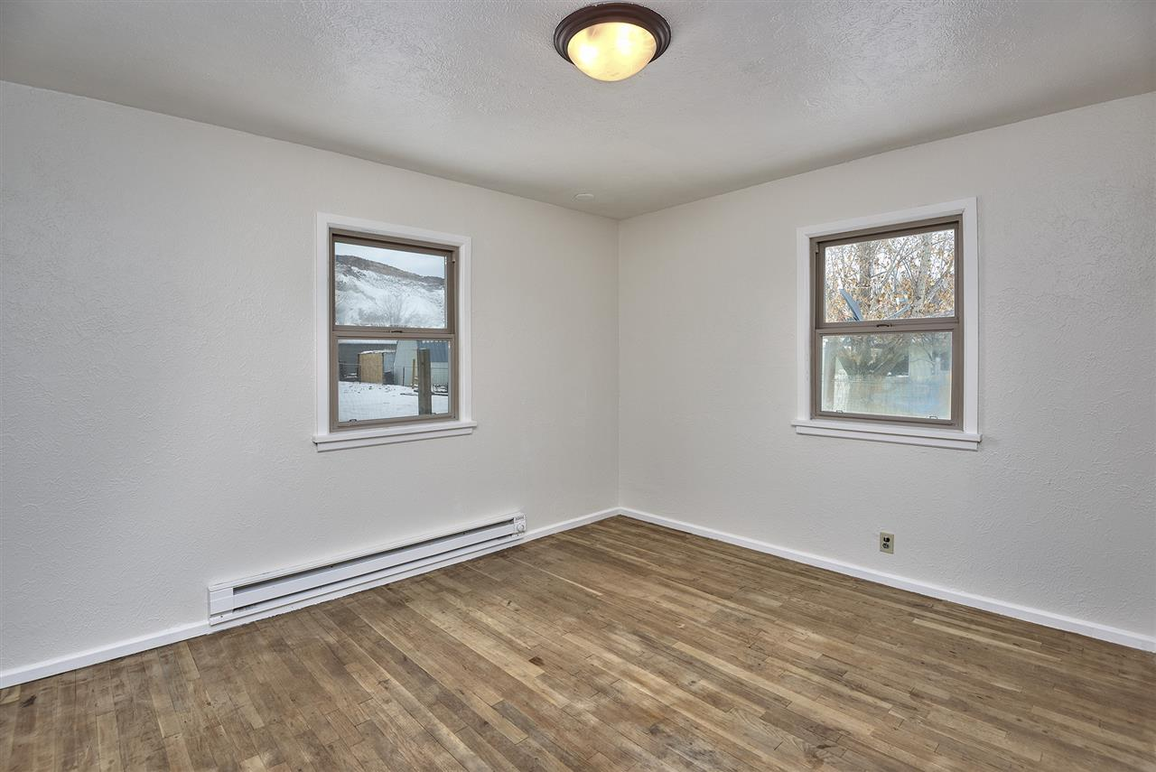 You'll love the original hardwood flooring still in both bedrooms in this classi