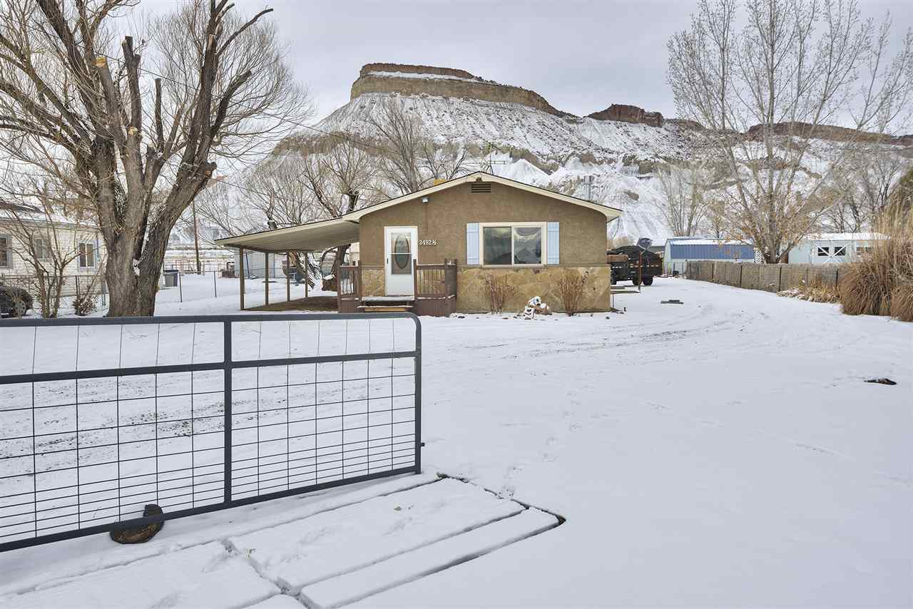 Bring the horses - and more! This home offers just over an acre of land with no