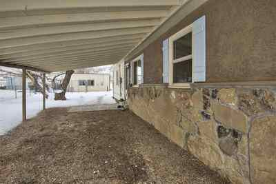 A one-car carport is attached to the home, and there is a separate one-car garag