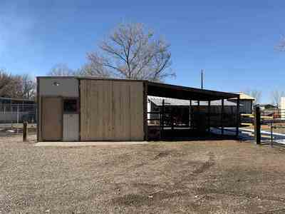 There's a one-car garage with an attached workshop and lean-to out back!