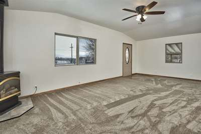 This home's spacious living room is mated to two bedrooms and one bathroom in 1,